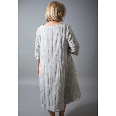 Ralston Hilma dress with a stripe in a natural coloured linen and asymmetric hemline. Available on colmershill.com