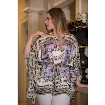 Isabel Giotto Kimo Kimono is truly a very special piece for your wardrobe. In a very feminine print on white, it has lilac, pink and khaki in a kaleidoscope-esque print. Available from colmershill.com