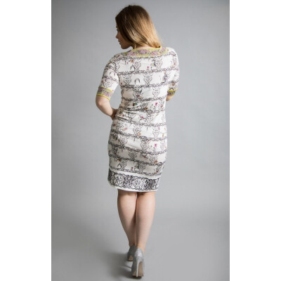 Isabel Giotto Impero Dress is an exquisitely feminine dress with a whimsical print on a sharp white background. Available from colmershill.com