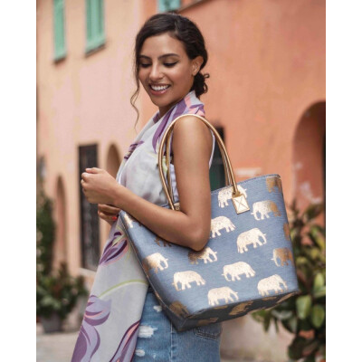 Powder Elephant print beach bag in gold and pale blue available on colmershill.com