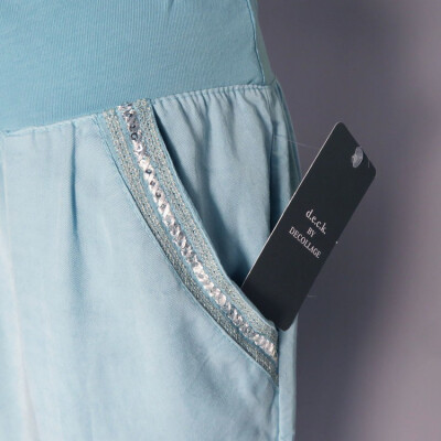 DECK tencel trousers pocket detail with silver sequin embroidery around the pocket, available on colmershill.com
