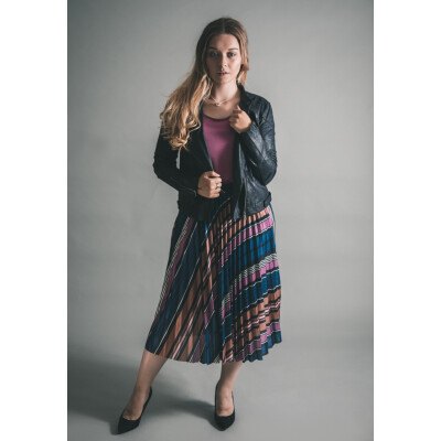 Soaked in Luxury Pippa Pleated Skirt in purple worn with the Columbine Tee and Sandwich Pleather Biker Jacket, all available on colmershill.com