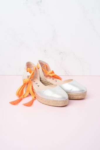 Cara Soda Silver Leather Espadrille with orange ribbon ankle ties available on colmershill.com
