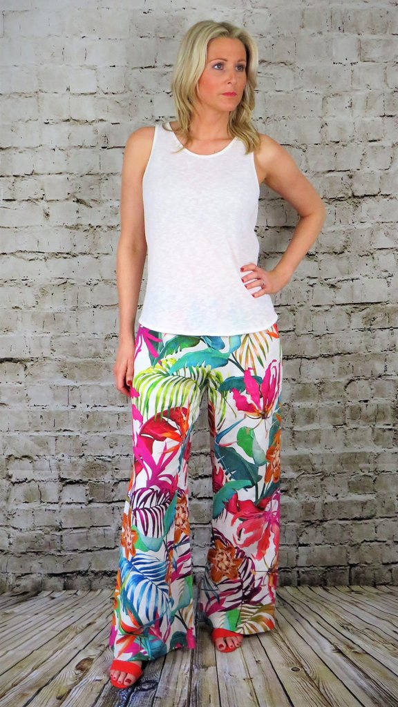 Out of Xile Wide Trousers with an elasticated waist. The trousers have a multi-colour exotic floral print 26SS20 available on colmershill.com
