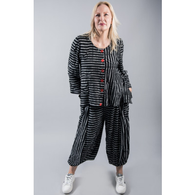 Ralston Otim black & white striped jacket with red buttons worn with the Amu wide funky jersey trousers available on colmershill.com