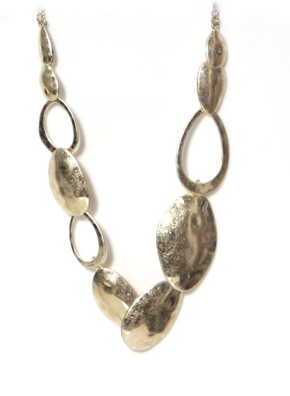 Envy gold statement necklace with beaten gold shaped plates and rings available on colmershill.com