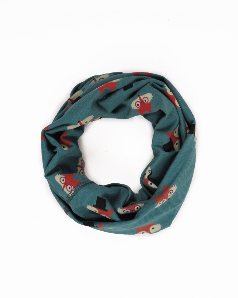 Powder Marvellous Multiway Band with a Fox Face print on a teal background can be worn in 8 different ways including a face mask, hat, snood. It is available on colmershill.com